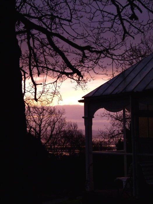 Sunset over a summerhouse
