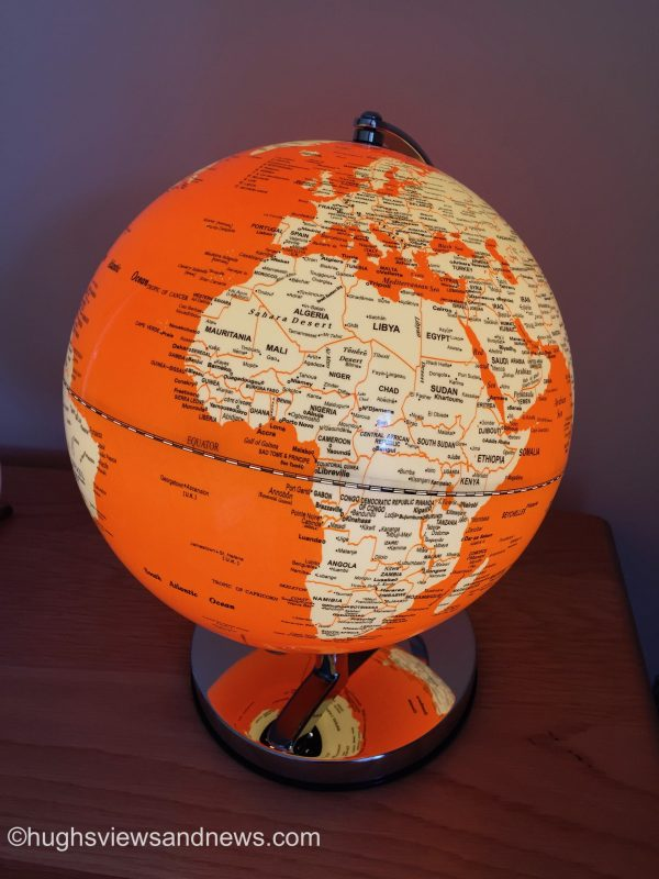 Photo of an orange globe of the Earth.