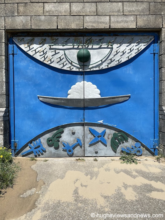 Photo of a blue door decorated with some mystical symbols